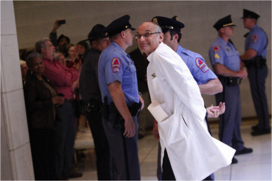 Dr. Charles van der Horst during his arrest after protesting for Medicaid Expansion at the North Carolina General Assembly.Photo courtesy of Dr. Charles van der Horst
